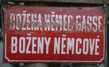 A street named after Božena Němcová with her name declined in the genitive case (a sign probably from the time of the Protectorate).