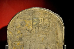 Detail of funerary stela of Amenemhat. The name of God Amun was erased by Akhenaten's agents. Limestone, painted. From Egypt, early 18thh Dynasty. The Burrell Collection, Glasgow