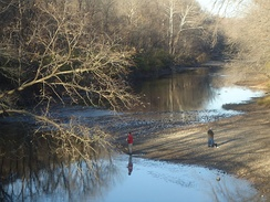 Two fishermen on the Vermilion River near the entrance to the Kickapoo State Park.