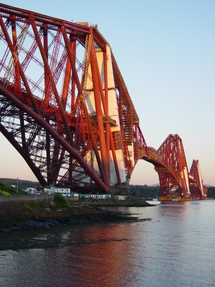 The Forth Bridge, designed by Sir Benjamin Baker and Sir John Fowler, which opened in 1890, and is now owned by Network Rail, is designated as a Category A listed building by Historic Environment Scotland.