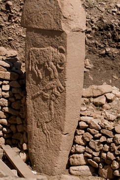Pillar from Göbekli Tepe with low reliefs of what are believed to be a bull, fox, and crane, 9600 to 8800 BCE.