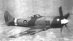 PR533, an early production Tempest F.B II. Note the underwing bomb racks.