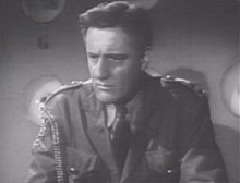 Henry Beckman as Commander Paul Richards in Flash Gordon.jpg