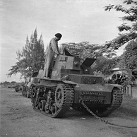 A soldier of an Indian armoured regiment examines a Marmon-Herrington CTLS light tank used by Indonesian nationalists and captured by British forces during the fighting in Surabaya.