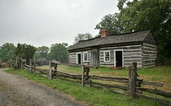 "The reconstructed ""Lincoln Log Cabin"" was the home of Thomas Lincoln and Sarah Bush Johnston Lincoln in Illinois."