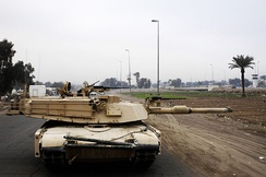 M1A1 Abrams with an Abrams Integrated Management System and the Tank Urban Survivability Kit conducting a patrol in Baghdad, 2007.