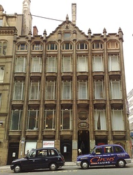 Oriel Chambers in Liverpool is the world's first glass curtain walled building. The stone mullions are decorative.