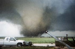 A tornado impacting the town of Roanoke, Illinois.