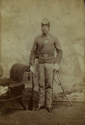 Sgt. John Harris of the 10th U.S. Cavalry with a Sharps rifle, c. 1868.