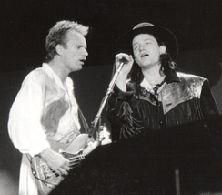 Bono (right) with Sting during A Conspiracy of Hope in 1986