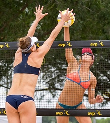 Unlike indoor volleyball, a touch off the block counts as one of the three allowed touches.