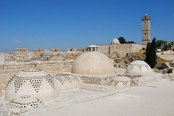 Aleppo Citadel, roof of the baths, with the mosque and minaret in the background.
