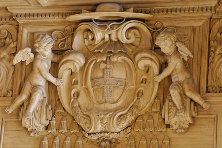 Carved coat of arms of Mazarin on a bookcase in the Bibliothèque Mazarine in Paris