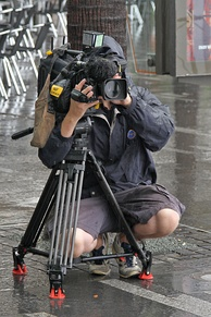 Ten News camera operator filming a traffic piece in Sydney by Vic Lorusso