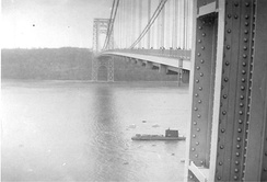 USS Nautilus passes under the bridge in 1956, when the bridge had only a single deck.