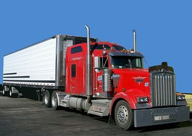 Class 8 Kenworth W900 tractor with spread-axle 48-foot (14.63 m) refrigerated trailer.
