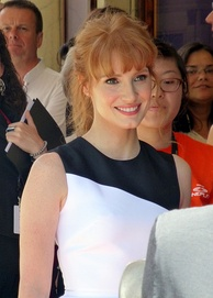 A shot of Jessica Chastain smiling away from the camera