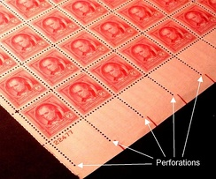 Rows of perforations in a sheet of postage stamps.
