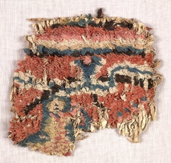 Carpet fragment, Loulan, Xinjiang province, China, dated to 3rd-4th century AD. British Museum, London