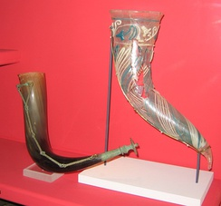 Vendel Period bronze horn fittings and 3rd century glass drinking horn on display  at the Swedish Museum of National Antiquities.