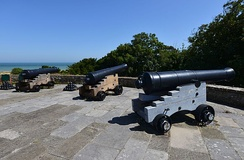 Three cannons on the one of the castle's firing platforms