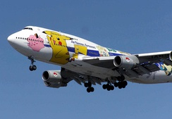 The ANA Boeing 747-400 airplane painted with Pikachu and other Pokémon (visible: Clefairy, Togepi, Mewtwo, and Snorlax)