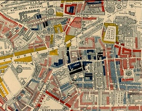 "Part of Charles Booth's poverty map showing Westminster in 1889. The colours of the streets represent the economic class of the residents: Yellow (""Upper-middle and Upper classes, Wealthy""), red (""Lower middle class – Well-to-do middle class""), pink (""Fairly comfortable good ordinary earnings""), blue (""Intermittent or casual earnings""), and black (""lowest class ... occasional labourers, street sellers, loafers, criminals and semi-criminals""). Booth coloured Victoria Street, with its new shops and flats, yellow. The model dwellings built by the Peabody Trust on the side streets off Victoria Street appear as  pink and grey, signalling modest respectability, while the black and blue streets represent the remaining slum areas housing the poorest.[5]"