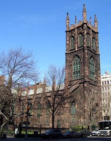 Exterior of Gothic Revival style church with a large tower.