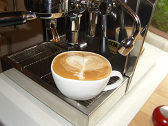 A flat white with latte art.