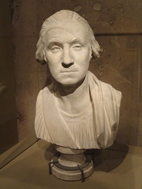 During the design process, Houdon produced this plaster bust of Washington in 1786. He later revised it before making the final statue. (National Portrait Gallery)