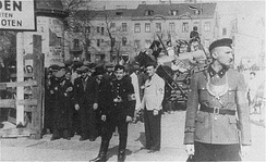 German and Jewish police guard at the entrance to the Ghetto