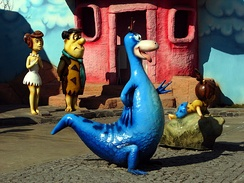Dinosaurs co-existing with hominids, as here in The Flintstones, is a relatively common anachronistic depiction in comics and animated cartoons.