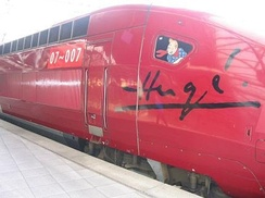 A Thalys train decorated with a Tintin vignette and Hergé's signature
