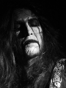 A common black metal convention is the use of corpse paint, black-and-white make-up intended to make the wearer look inhuman, corpse-like, or demonic. Shown here: Taalroth of French pagan band Hindvir.