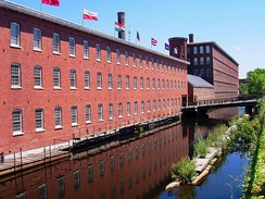 Textile mills such as the one in Lowell made Massachusetts a leader in the Industrial Revolution.