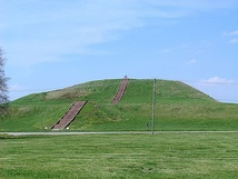 Monks Mound in Cahokia, a UNESCO World Heritage Site and the largest and most influential settlement in Mississippian culture. The concrete staircase follows the approximate course of ancient wooden stairs.