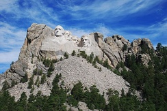 Mount Rushmore, showing the full size of the mountain and the scree of rocks from the sculpting and construction.