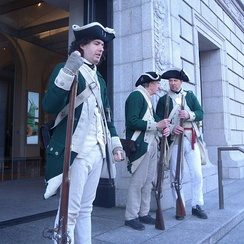 Re-enactment of loyalist colonial troops guard the Society building from George Washington's Rebels