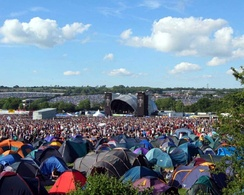 "Glastonbury Festival's ""Other Stage"" in 2004 with tents in the foreground"