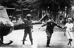Escorted by armed guards, Pat Nixon (far right) arrives via helicopter on the ground in South Vietnam, July 31, 1969. It was the first time a first lady had entered a combat zone.