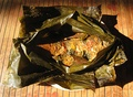 Carp fish in spices and herbs cooked in a banana leaf package, Sundanese