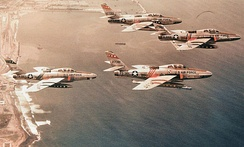 Republic RF-84F-25-RE Thunderflashes of the 66th Tactical Reconnaissance Wing flying over the coast of Morocco near Nouasseur Air Base, 1958. Identified serials are 51-17011, 52-7318, 52-7343 and 52-7295. All of these aircraft were sold to the German Air Force. 17011 was later sold to the Greek Air Force and 7381 to the Italian Air Force. 17011 is now on permanent display at the Hellenic AF Museum, Dekelia AB, Athens.
