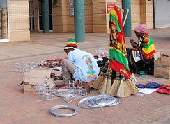 Two Rasta street vendors in Zeerust, South Africa; they are wearing and selling items that display their commitment to the religion