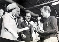 Queen Elizabeth II presenting the Jules Rimet trophy to 1966 World Cup winning England captain Bobby Moore