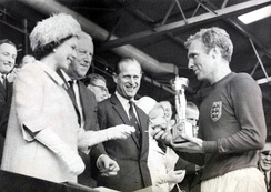 Queen Elizabeth II presenting the World Cup trophy to 1966 World Cup winning England captain Bobby Moore