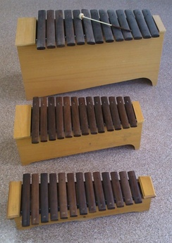 Three Orff-Schulwerk xylophones of different ranges.