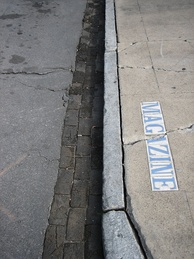 A curb with street name on the sidewalk in New Orleans
