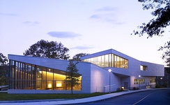 Brandeis's admissions building at night