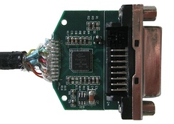 A DisplayPort to DVI adapter after removing its enclosure. The chip on the board converts the voltage levels generated by the dual-mode DisplayPort device to be compatible with a DVI monitor.