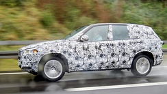 A camouflaged pre-production BMW X5 mule near Munich in October 2013
